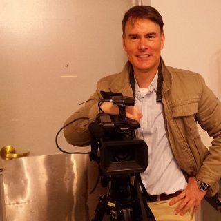 St John Alexander and His Camera